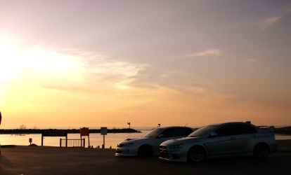 GR STi Sedan and Evo X in the sunset
